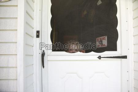 portrait of girl seen through door