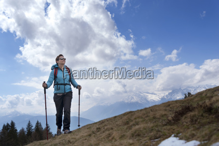 female hiker walking on mountain against