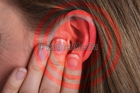 red circle pattern on womans ear