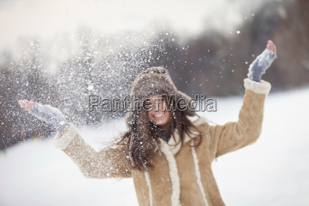 portrait of excited woman playing with