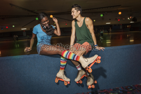 friends wearing roller skates sitting at