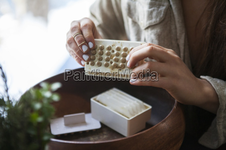 midsection of woman making medicines in