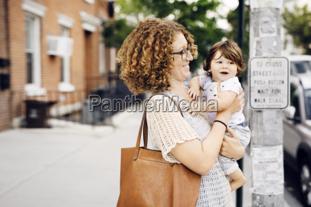 happy mother holding baby boy while