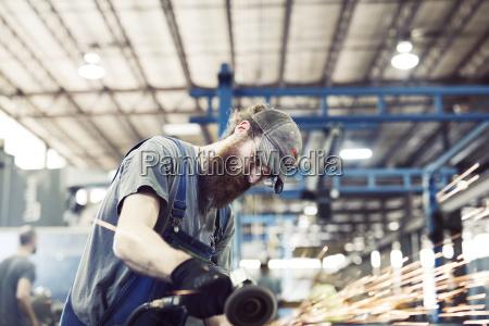 worker using welding machine in steel