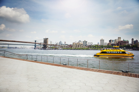 ferryboat moving on river by promenade
