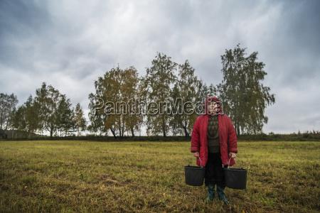 portrait of female farm worker holding