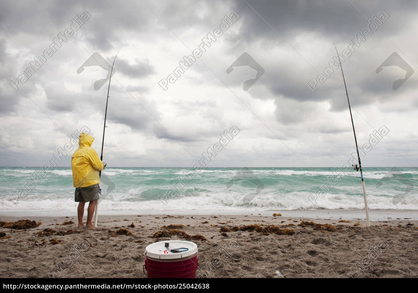 man, holding, fishing, rod, while, standing - 25042638