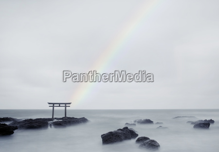 rainbow over tall torii gate on