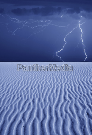 thunderbolts of lightning over desert at