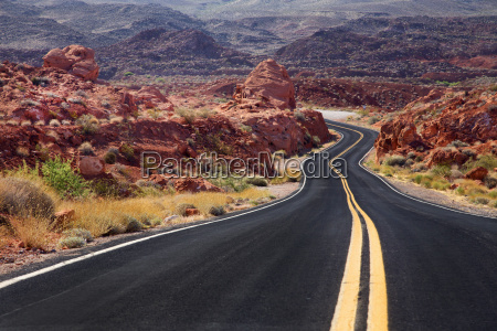 rural road winding through remote mountain