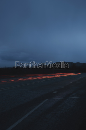 red light trails on road against