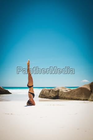 mid adult woman in bikini doing