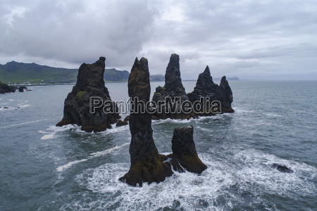 stack rocks in sea against cloudy