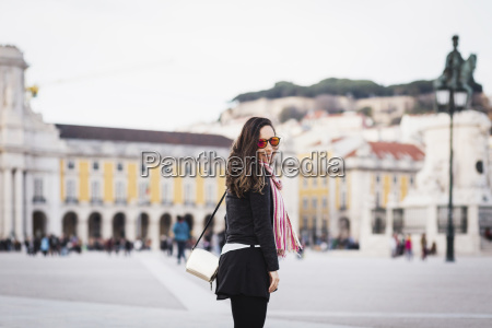 smiling mid adult woman standing at