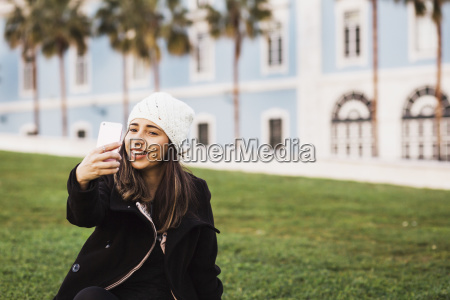 mid adult woman taking selfie from