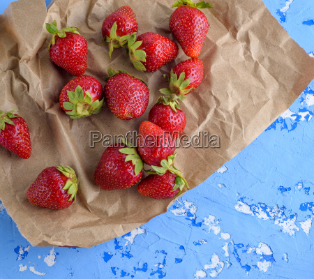 fresh ripe red strawberry on brown
