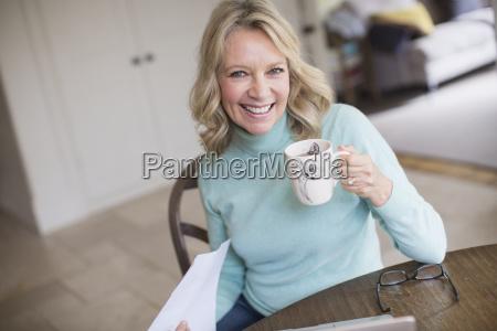 portrait smiling confident mature woman drinking