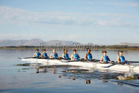 female rowing team rowing scull on