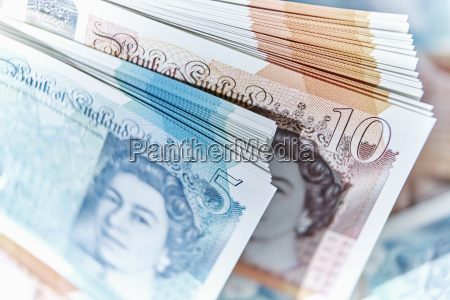 five and ten pound note stacks
