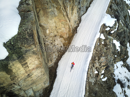 aerial view of person skiing beside