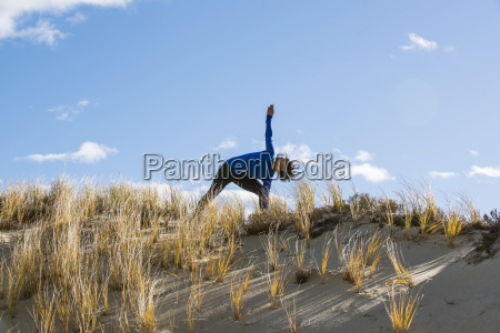 woman stretching on sand newburyport massachusetts