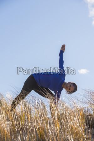 woman stretching outdoors newburyport massachusetts usa