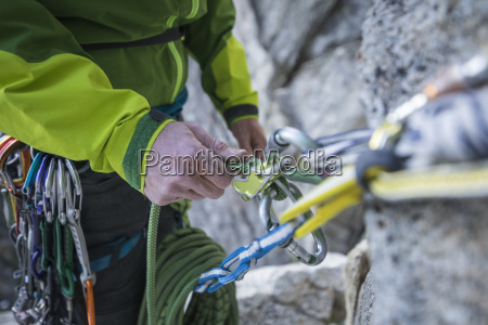 rock climber belaying partner on lovers