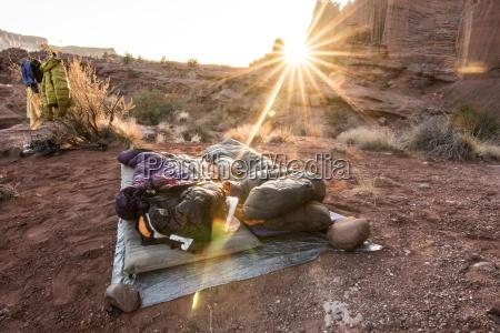 people sleeping in sleeping bags in