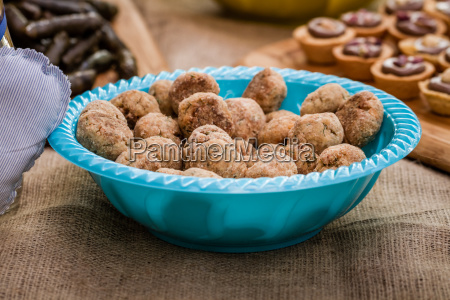 cookie balls in a blue bowl