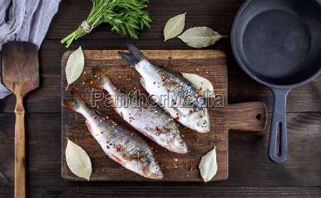 river fish on a brown wooden