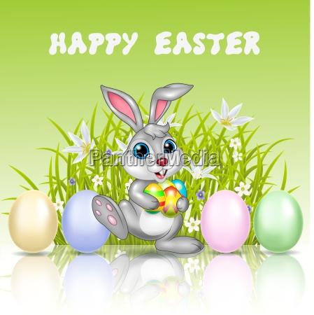 happy cartoon bunny holding an easter