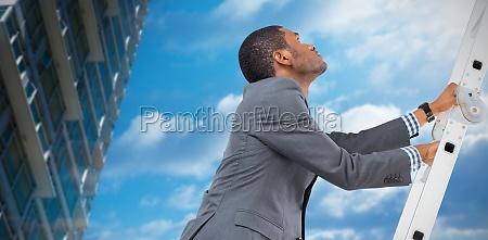 composite image of businessman climbing up