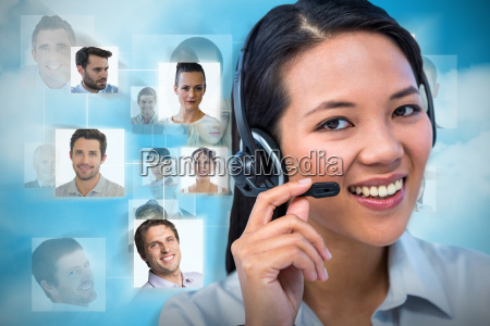 composite image of smiling businesswoman using