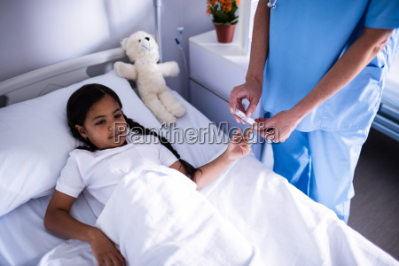 female doctor checking a sugar level