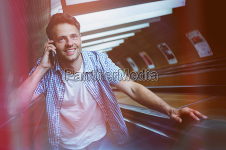 handsome man using mobile phone on
