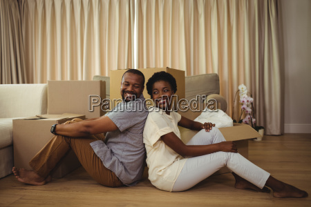 portrait of couple sitting back to
