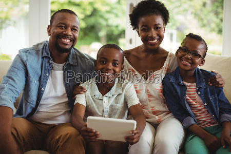 parents and son using digital tablet