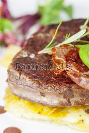 grilled steak on gratin