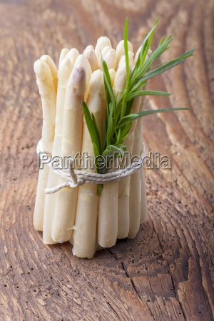 white asparagus on dark wood