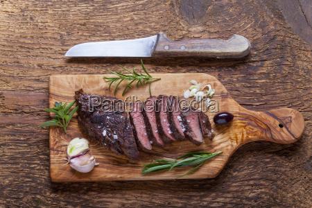 grilled steak on wood