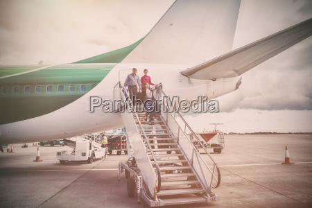 people disembarking from airplane