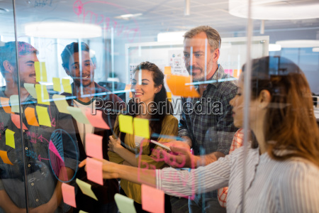 creative business team looking at sticky