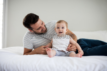 father playing with his baby girl