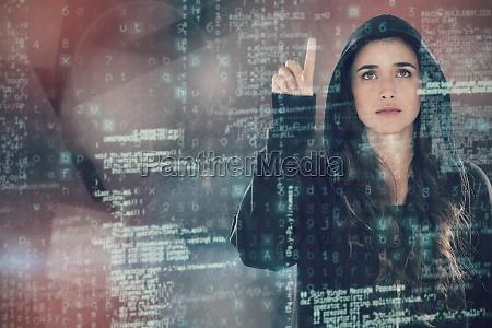 composite image of hacker using digital