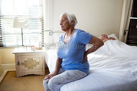senior woman suffering from backache in