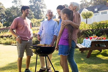 family preparing barbecue in the park