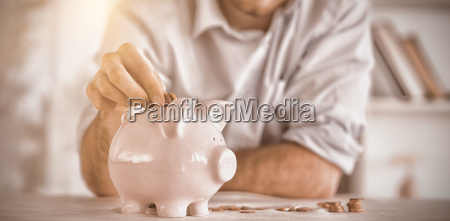 change being put into piggy bank