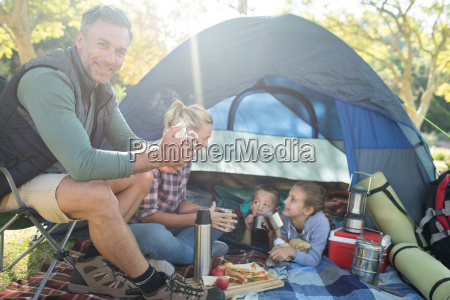 family, having, snacks, and, coffee, outside - 25083756