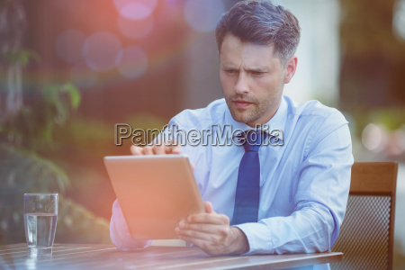 confused businessman using digital tablet