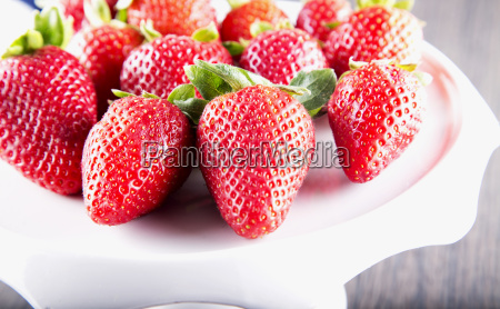 strawberries over white stand